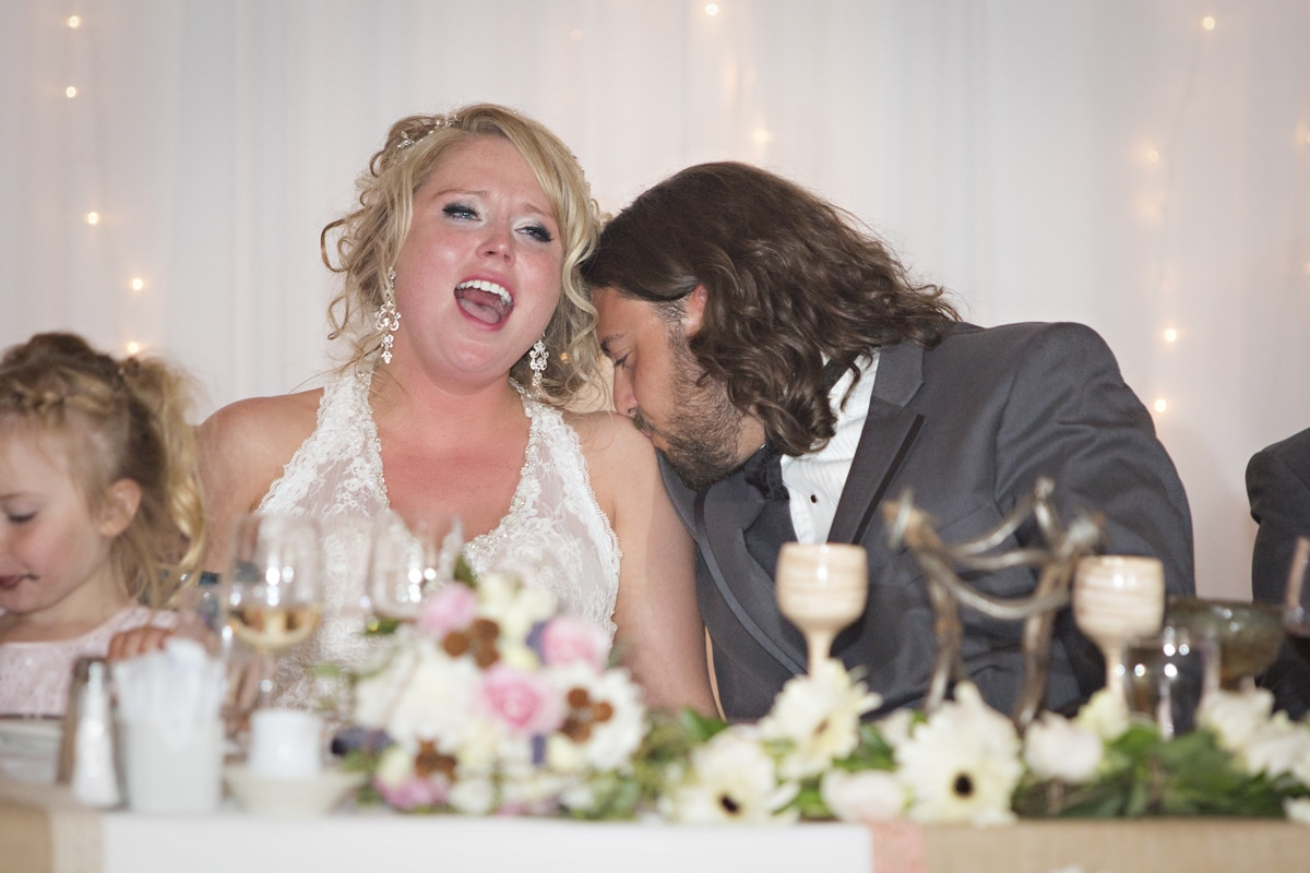 bride crying while groom kisses her shoulder A Different A Different Angle Photography Jasper