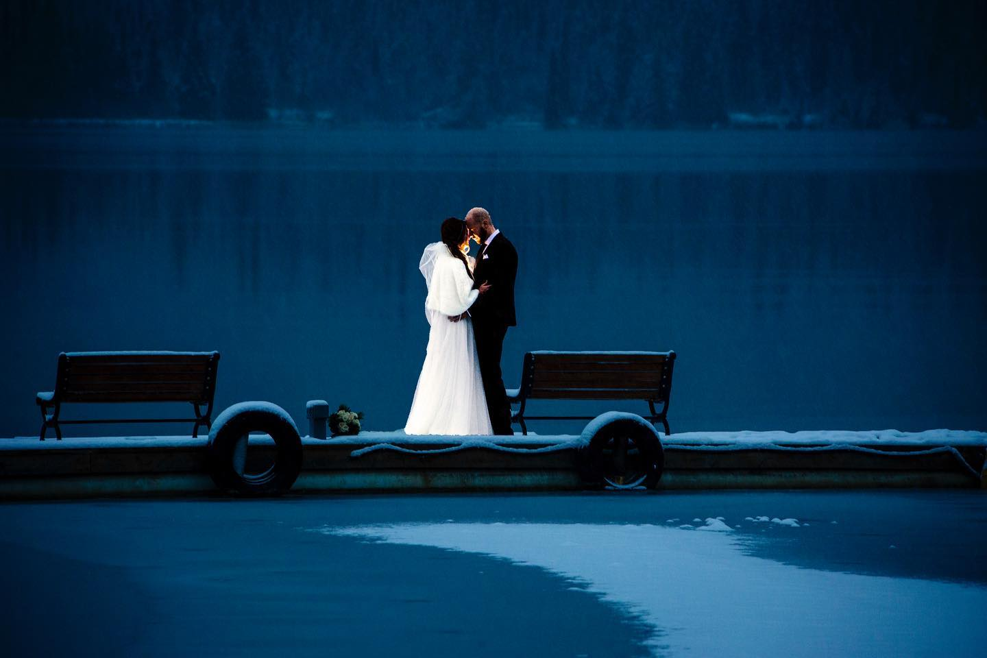 wedding couple standing on dock at night time- evening portraits at your Jasper wedding