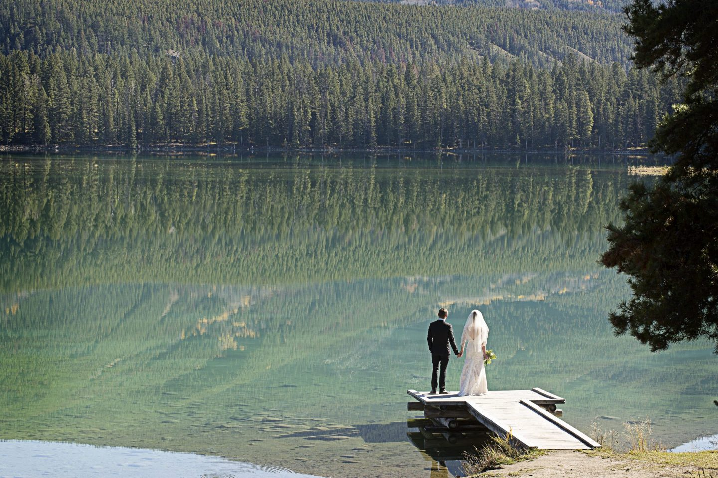 couple looking out at the water in Jasper Alberta