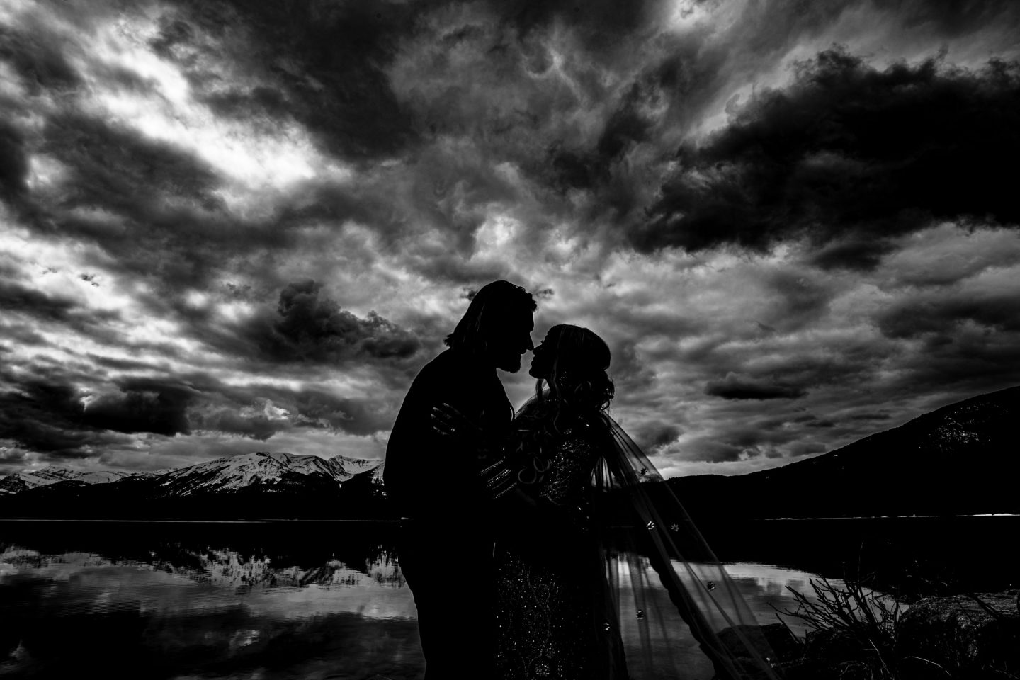 silhouette of man and woman with clouds in the background -8 uses for your Jasper engagement photos