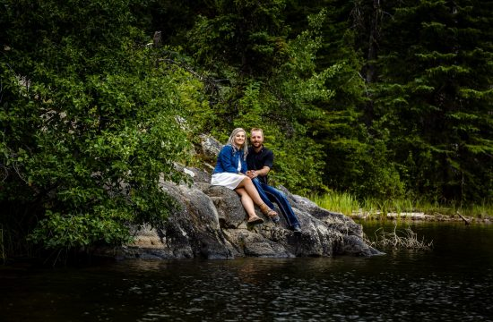 couple sitting on the rocks and looking at the camera-pyramid island engagement session