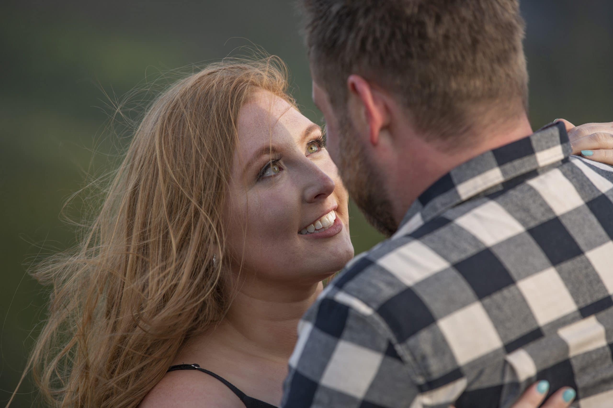 woman gazing up at man lovingly