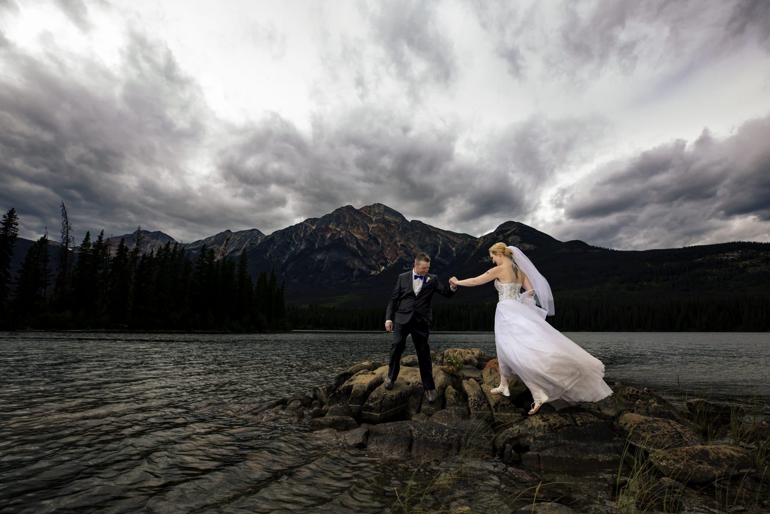 wedding couple walking on rocks on Pyramid Lake