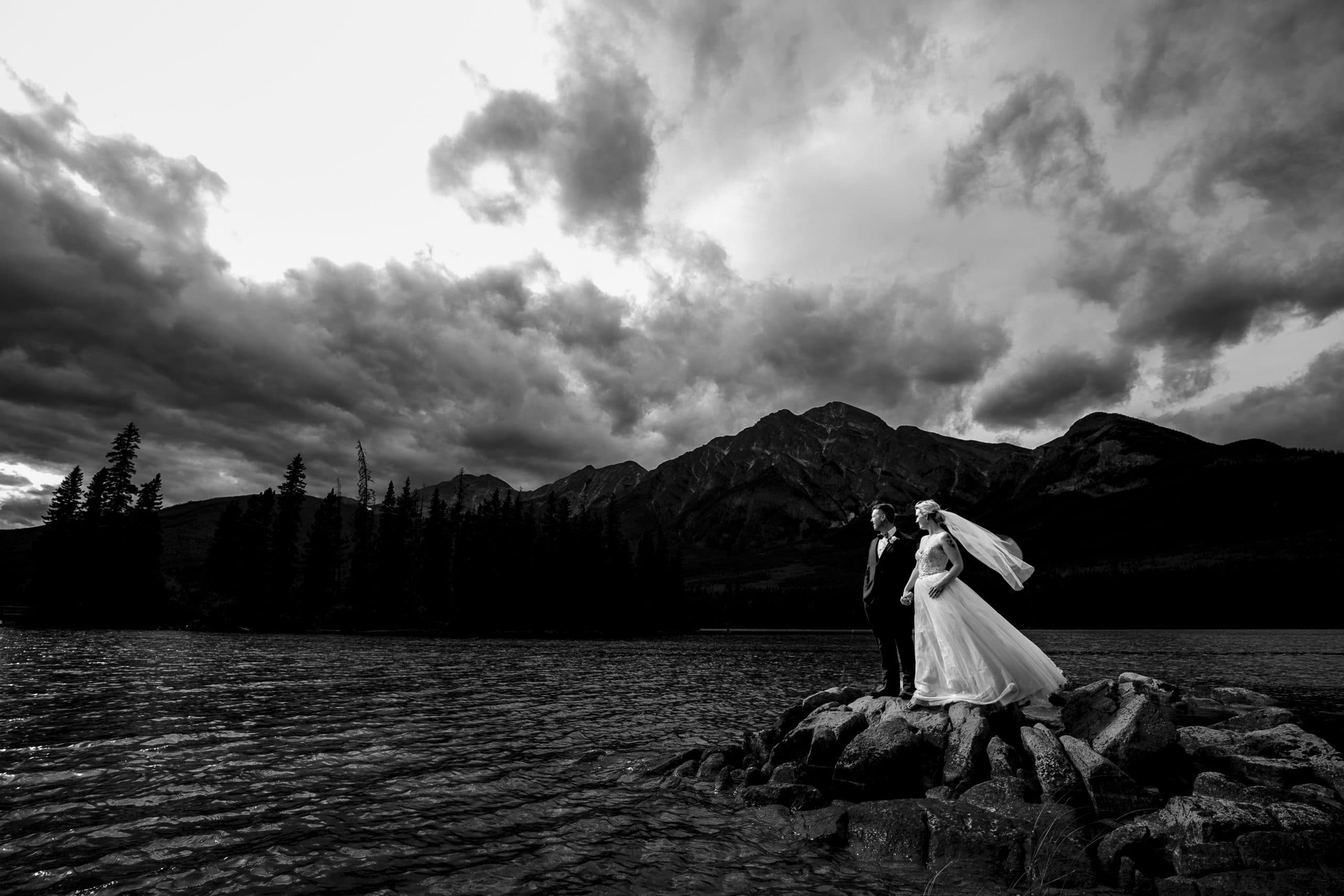 black and white image of bride and groom on Pyramid Lake
